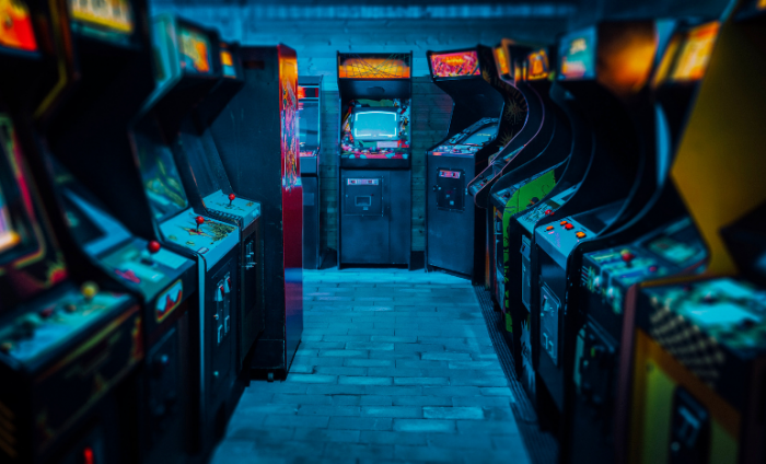 Low lighted image of old Pac Man style video games