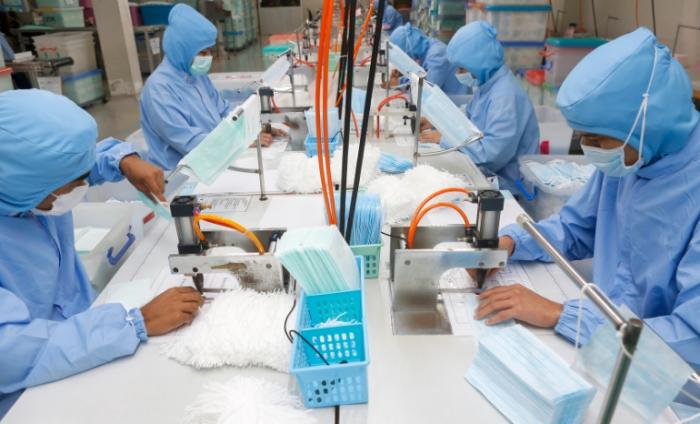 Image showing workers in PPE in a factory making face coverings