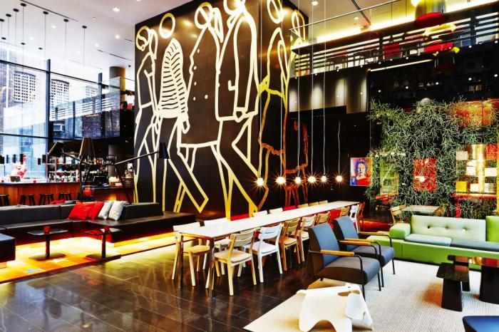 The interior of citizenM Times Square. citizenM led a talk on transformation for UCL School of Management's IMB students