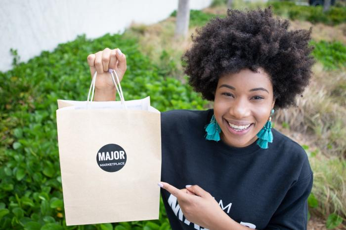 MSc Entrepreneurship Leyanis Diaz Gil with a bag from her startup - Major Marketplace. Leyanis has been chosen for the WBENC Student Entrepreneur Programme in 2019