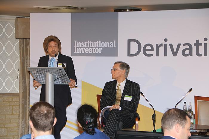 Dr George Namur, left, and Dr Pete Clark, right, discussing acquisitions on stage at the 2019 Derivatives Summit.