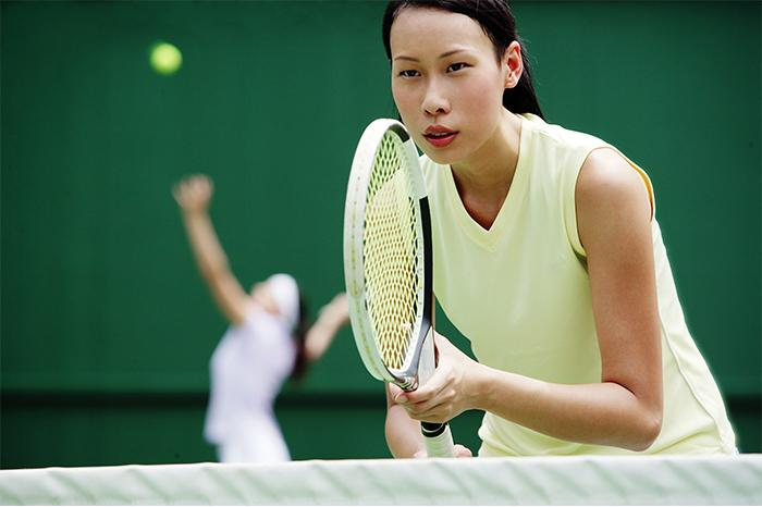 Photo of a woman playing tennis
