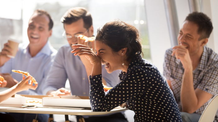 People laughing in a work meeting